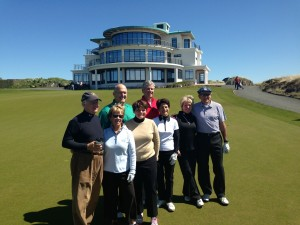 PerryGolf clients in front of Castle Stuart Clubhouse