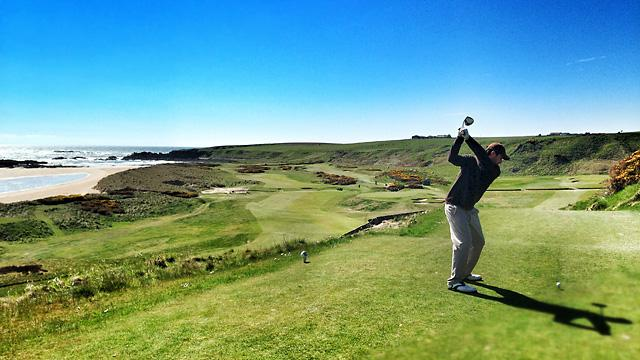 The author tees off on the 10th hole of Cruden Bay, the idealized essence of Scottish golf. Photo by Matt Ginella