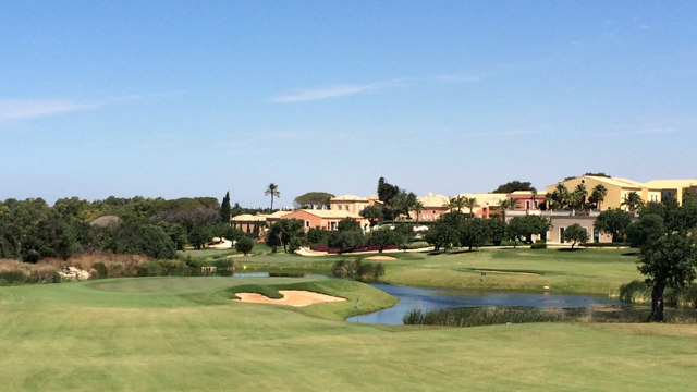 Donnafugata Golf Resort & Spa's downhill par 5 #7 with the backdrop of the clubhouse. A Gary Player design, and just 4 years old, the course is in remarkable condition!