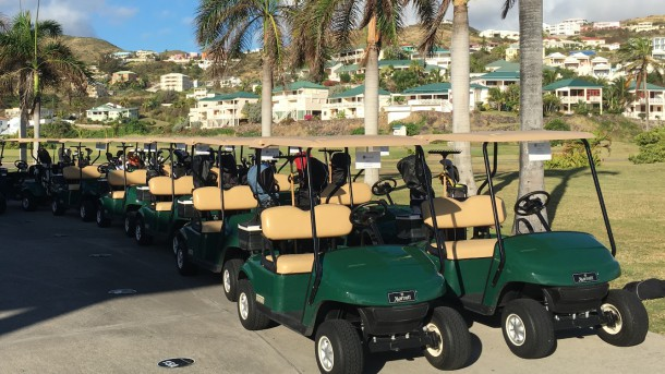 Royal St. Kitts Golf Club - Golf carts lined up and ready to roll - PerryGolf.com