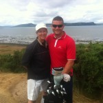 M. Koss of Richmond Canada celebrates a hole in one on Castle Stuart's par three #8. The first hole in one on the course since The Scottish Open won by Phil Mickelson. Pictured here with her caddie. Good club selection!