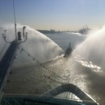 Azamara Quest is honoured with a water spraying tugboat escort for the final few miles of the beautiful River Elbe into the heart of Hamburg Germany