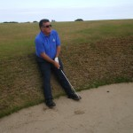 A. Larose taking a breather in one of the Old Course's many bunkers!
