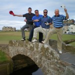 PerryGolf's Keith Baird, A. Larose and T. and S. Thompson on the Swilcan Bridge at the Old Course at St Andrews. — in St Andrews, Scotland.
