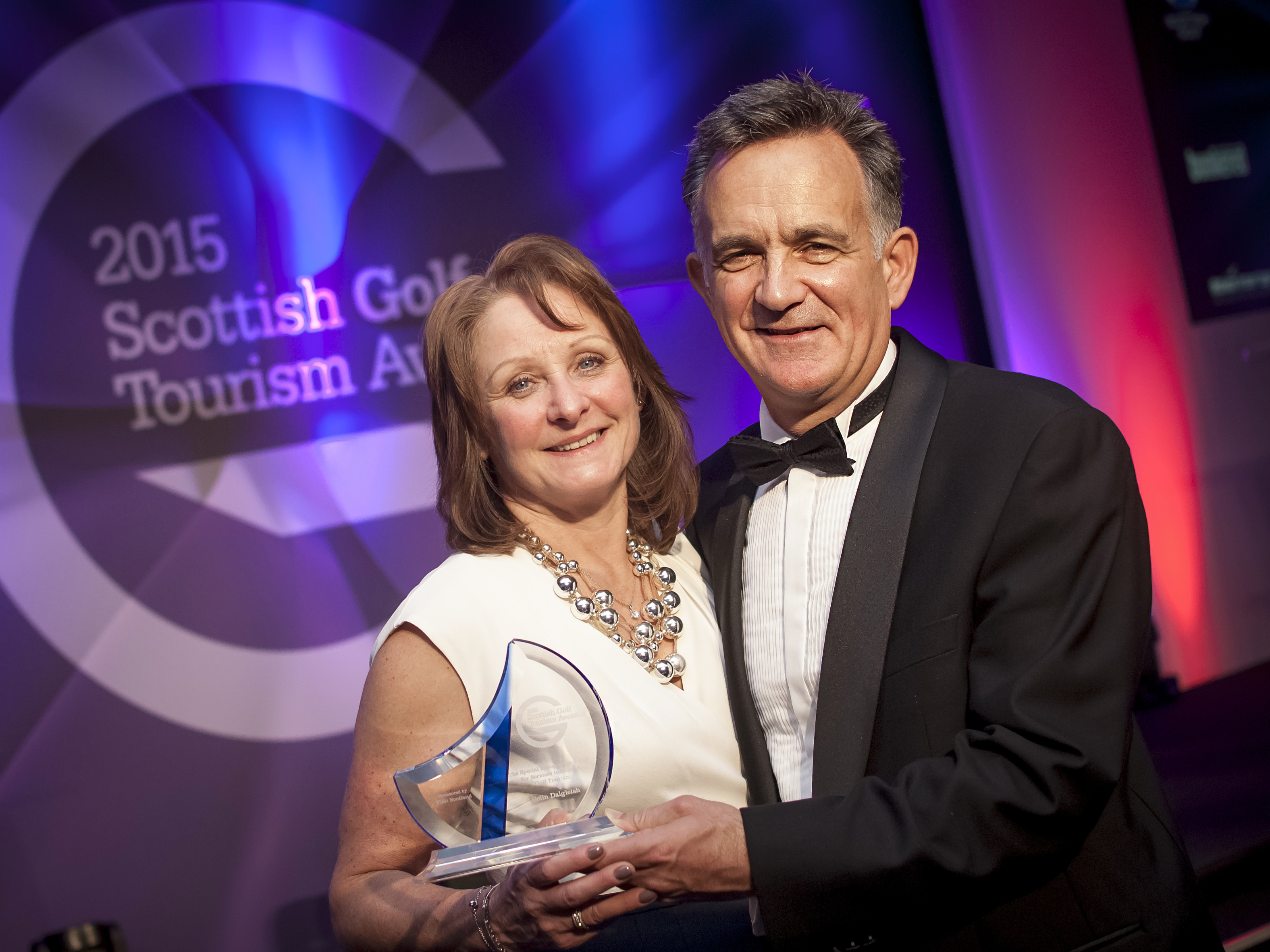 PerryGolf's Anne Filshie joins PerryGolf Co-Founder, Colin Dalgleish, in celebrating his receipt of a Special Recognition award at the 2015 Scottish Golf Tourism Awards