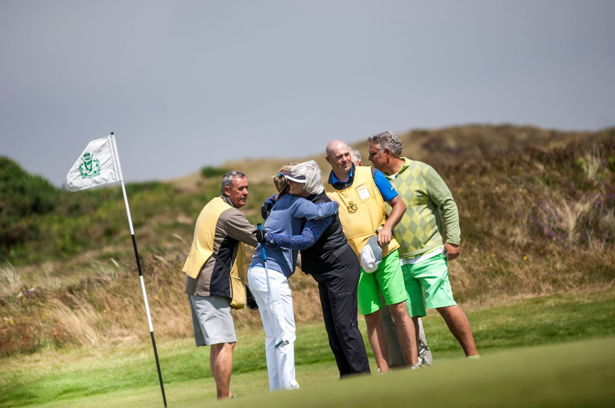 PerryGolf clients show sportsmanship at the conclusion of their round at at Royal County Down Golf Club.