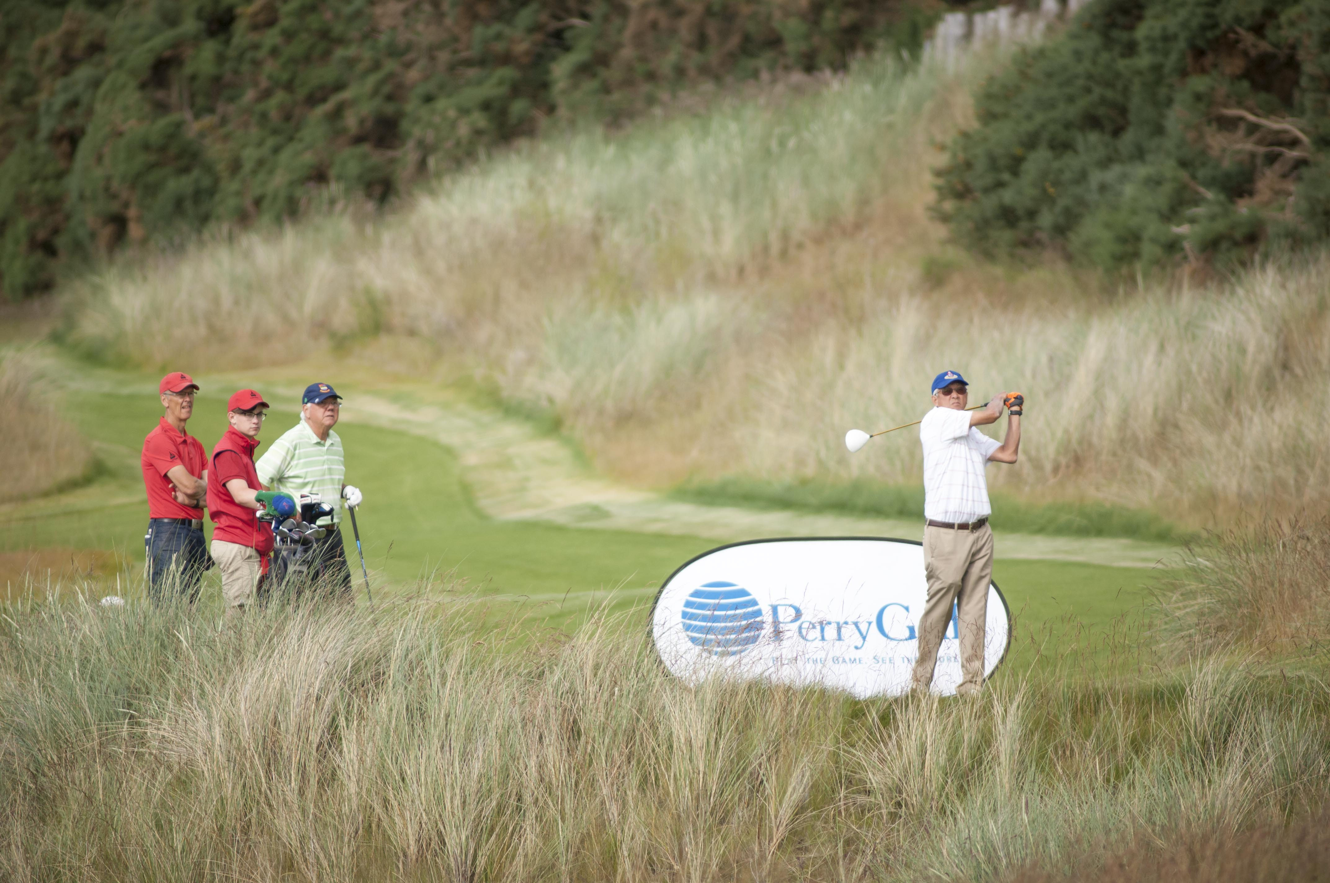 PerryGolf guest teeing off in Scotland at Castle Stuart Golf Links during our 2015 Open Championship Golf Cruise