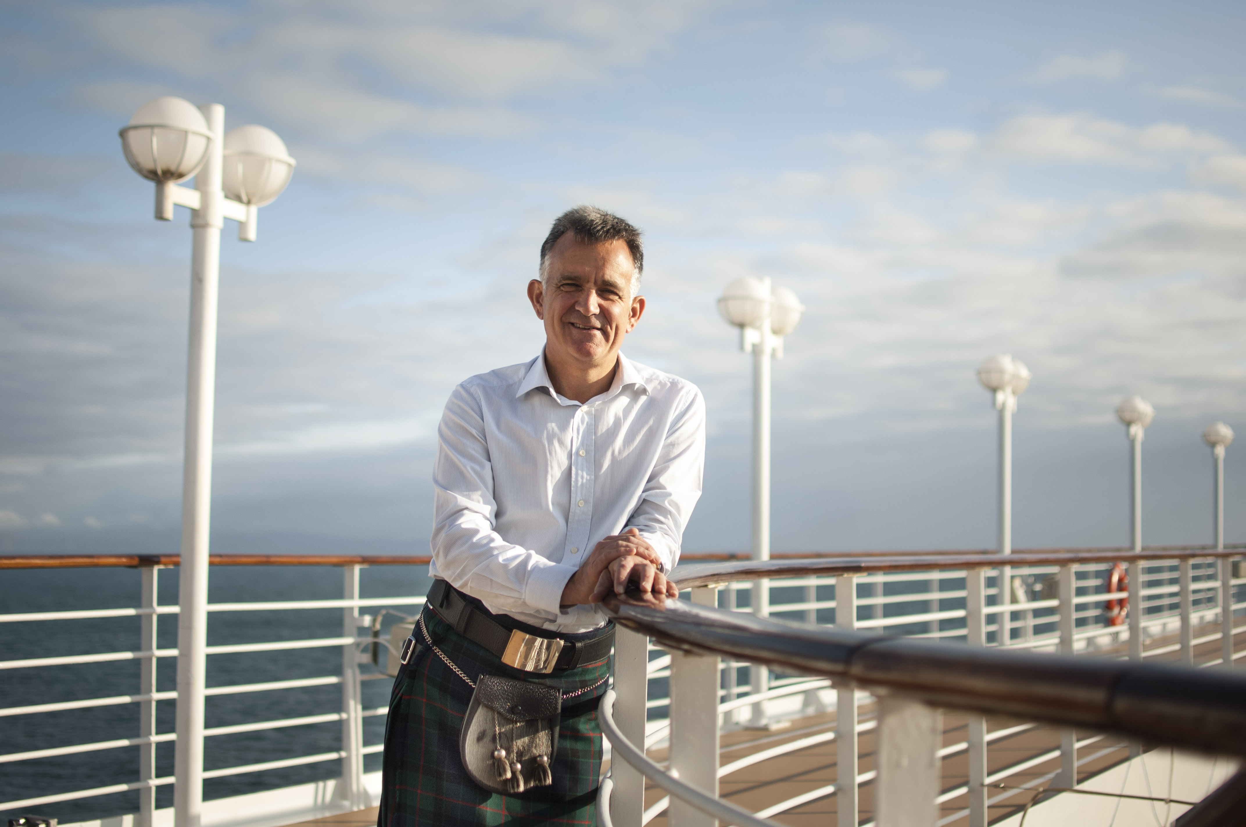 PerryGolf's Co-Founding Director, Colin Dalgleish, poses for photo on board Azamara Quest in his kilt during a PerryGolf Cruise